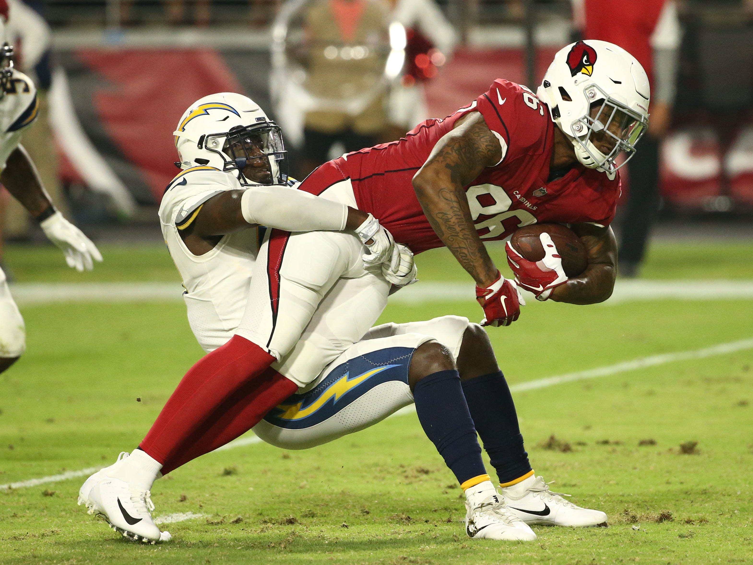 Arizona Cardinals Ricky Seals-Jones is tackled by the L.A. Chargers in the first half during a preseason NFL football game on Aug. 11, 2018 at University of Phoenix Stadium in Glendale, Ariz.