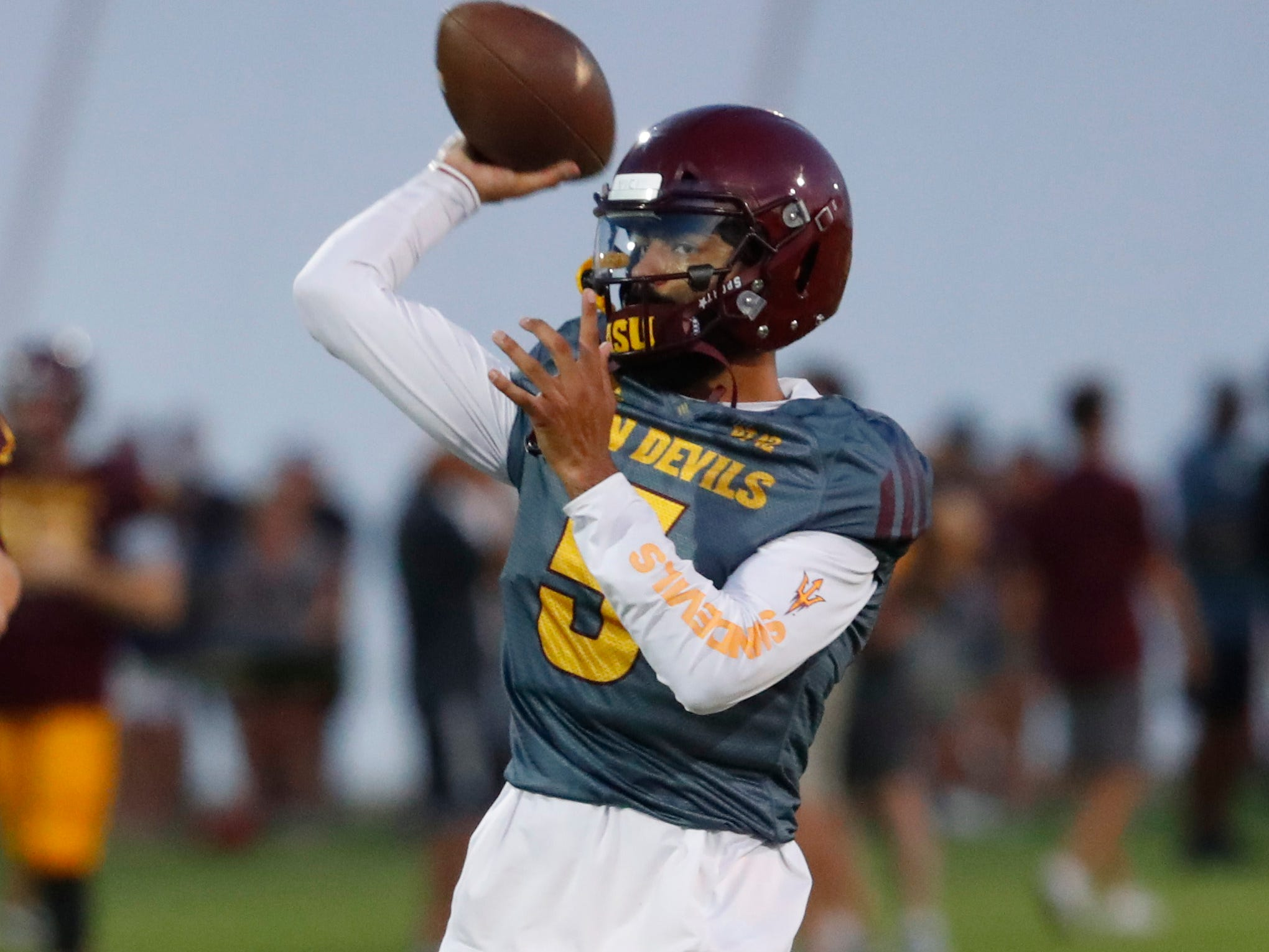 ASU's Manny Wilkins (5) throws passes during the ASU scrimmage at Kajikawa Practice Fields in Tempe, Ariz. on Aug. 11, 2018.