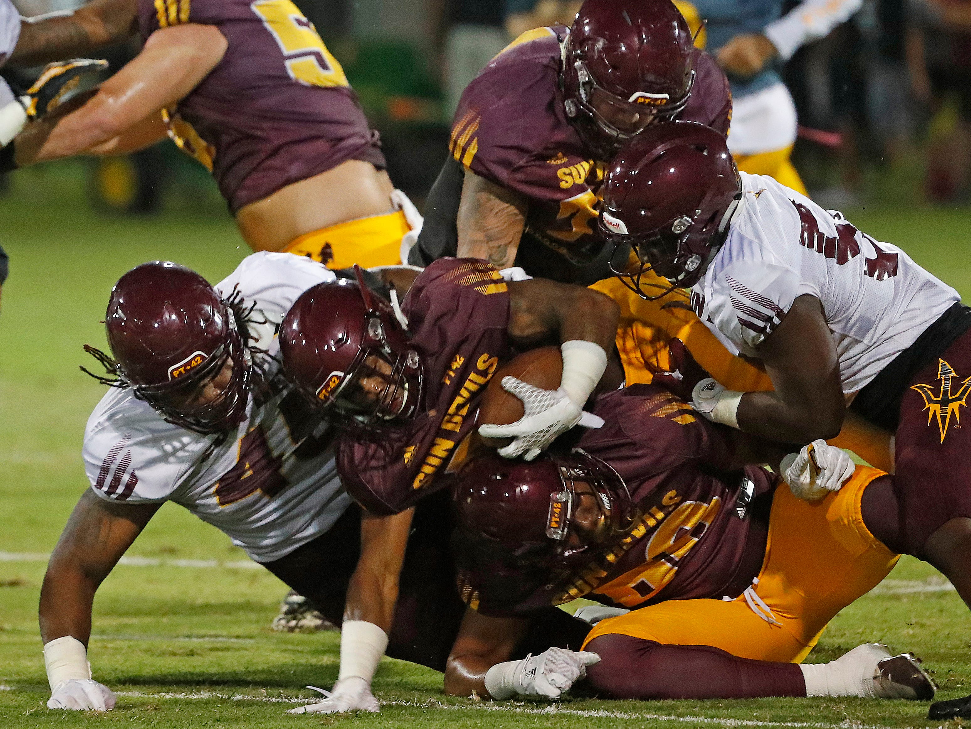 ASU's George Lea (45) tackles Isaiah Floyd (31) during the ASU scrimmage at Kajikawa Practice Fields in Tempe, Ariz. on Aug. 11, 2018.