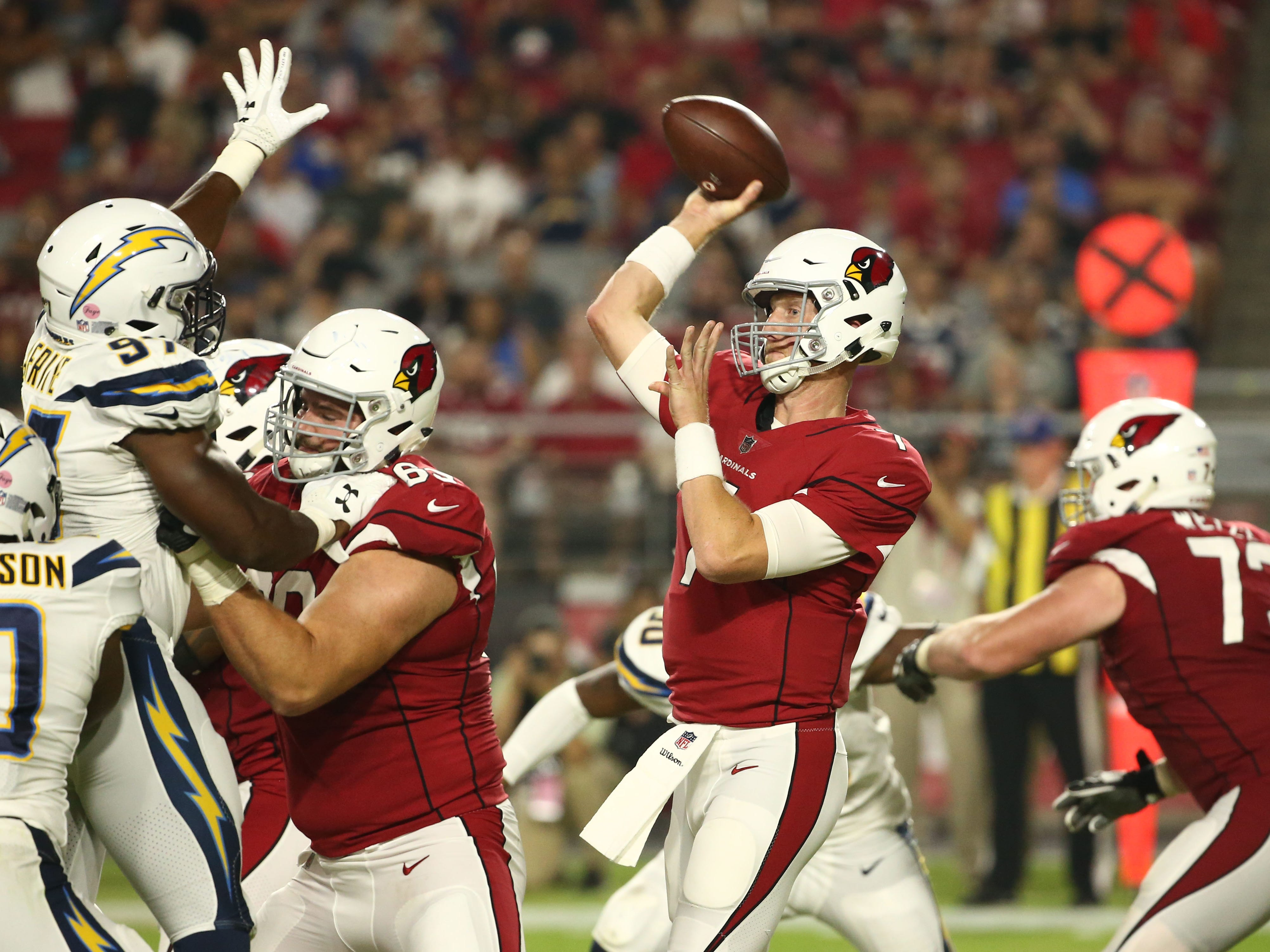 Arizona Cardinals quarterback Mike Glennon throws a pass against the L.A. Chargers in the second half during a preseason NFL football game on Aug. 11, 2018 at University of Phoenix Stadium in Glendale, Ariz.