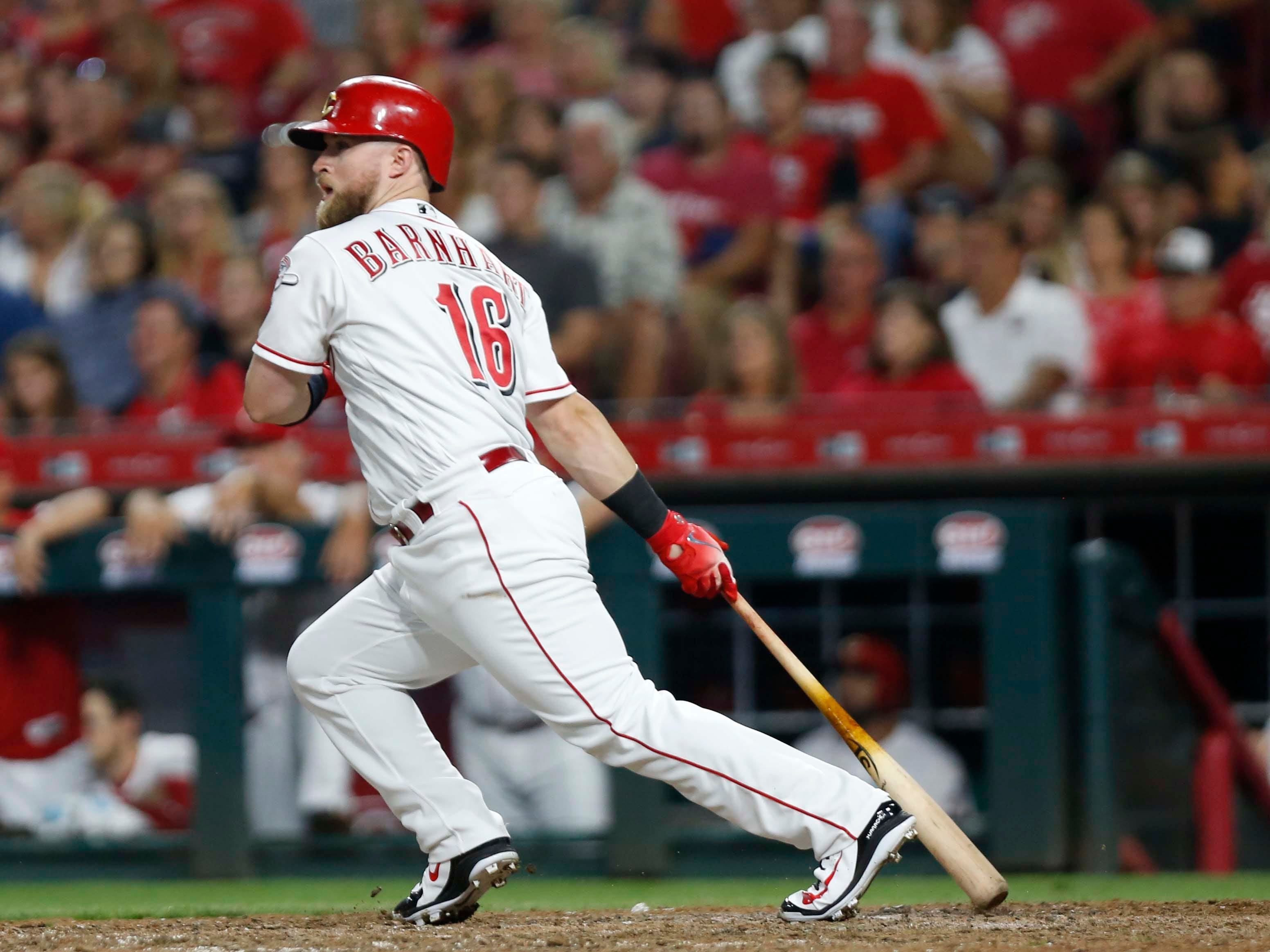 Aug 11, 2018; Cincinnati, OH, USA; Cincinnati Reds pinch hitter Tucker Barnhart (16) hits a two-run double against the Arizona Diamondbacks during the eighth inning at Great American Ball Park. Mandatory Credit: David Kohl-USA TODAY Sports