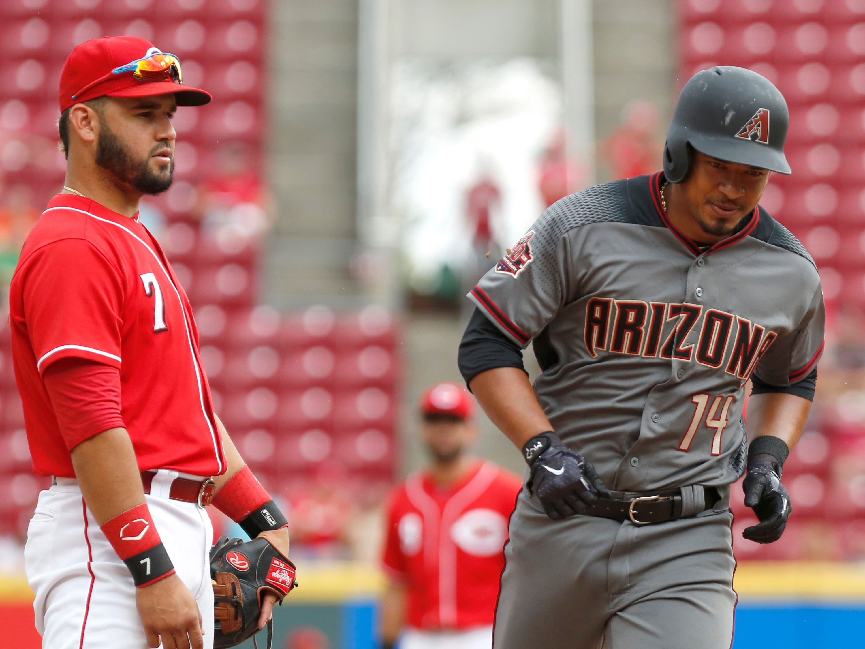 Aug 12, 2018; Cincinnati, OH, USA; Arizona Diamondbacks third baseman Eduardo Escobar (14) rounds the bases past Cincinnati Reds third baseman Eugenio Suarez (7) after hitting a two-run home run during the ninth inning at Great American Ball Park. Mandatory Credit: David Kohl-USA TODAY Sports