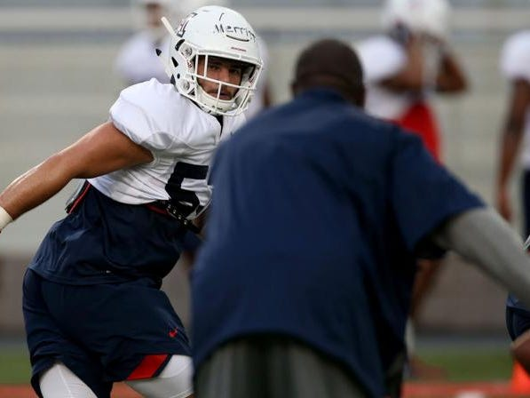 Linebacker Richard Merritt watches for the sign to change directions during a drill as the University of Arizona continues preparing for the upcoming season, Friday, August 10, 2018, Tucson, Ariz.