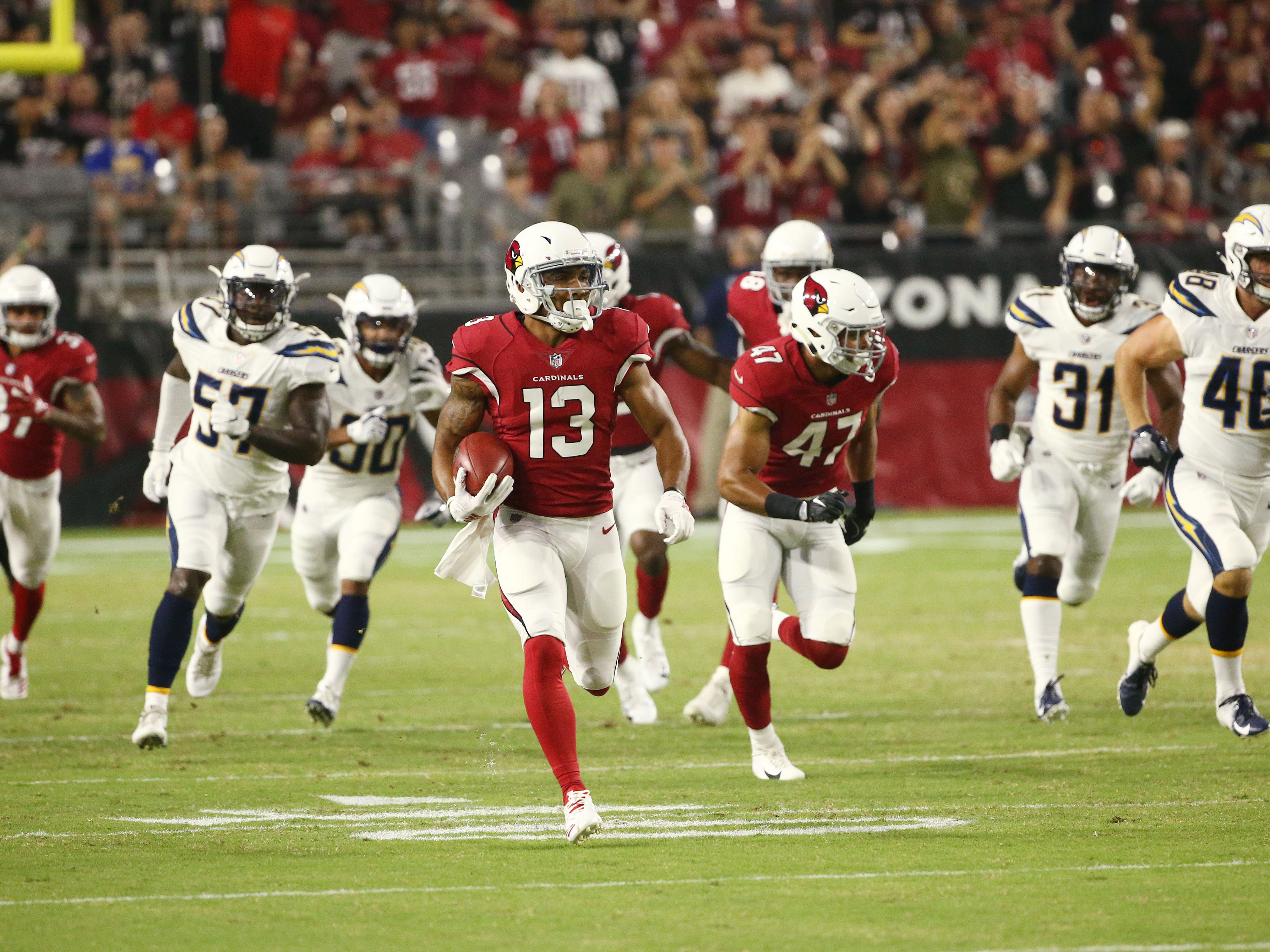 Arizona Cardinals Christian Kirk returns a punt against the L.A. Chargers in the first half during a preseason NFL football game on Aug. 11, 2018 at University of Phoenix Stadium in Glendale, Ariz.