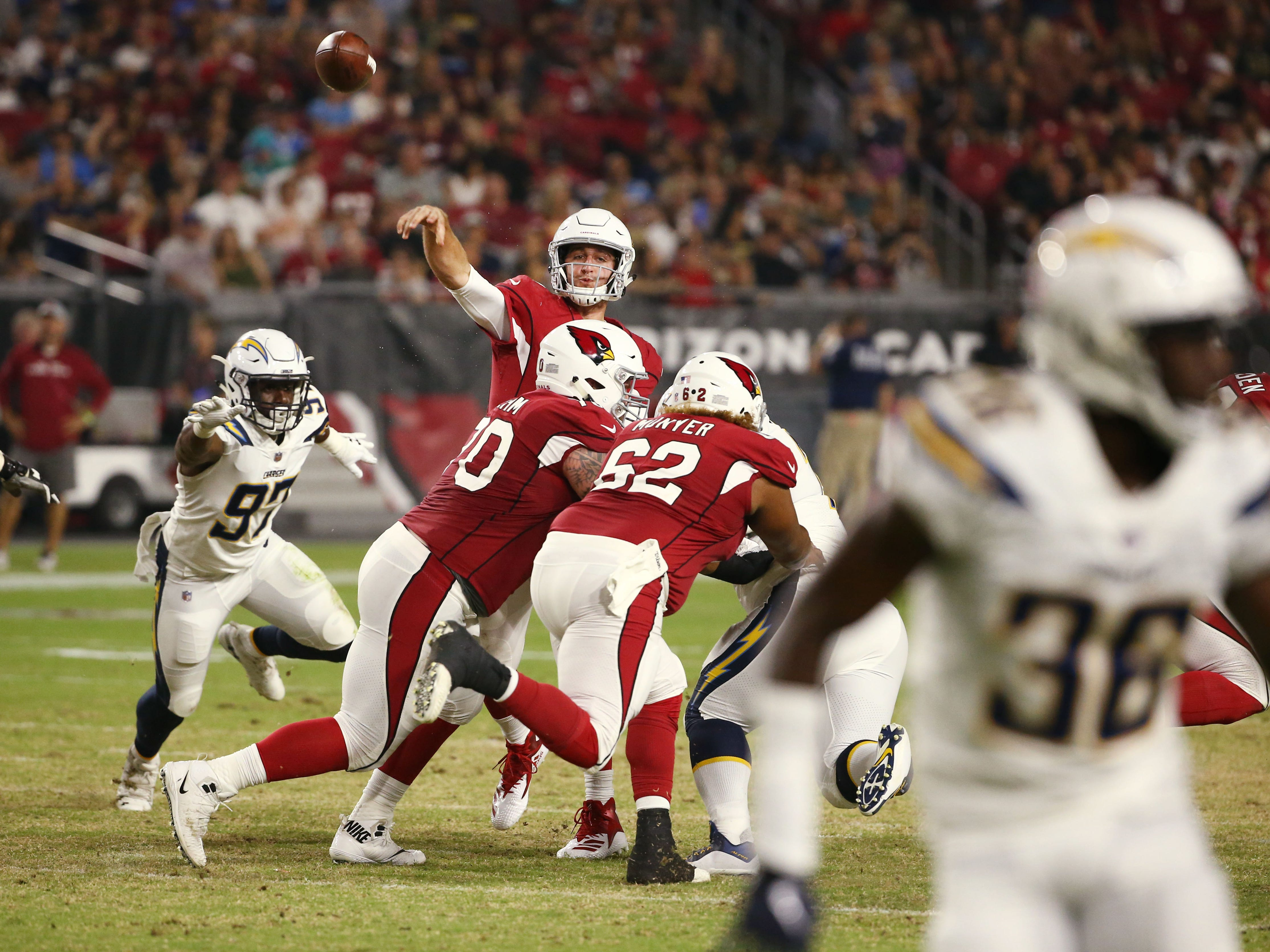 Arizona Cardinals quarterback Josh Rosen throws an incomplete pass against the L.A. Chargers in the first half during a preseason NFL football game on Aug. 11, 2018 at University of Phoenix Stadium in Glendale, Ariz.