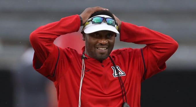 Head coach Kevin Sumlin watches the Wildcats run through their paces as the University of Arizona continues preparing for the upcoming season, Friday, August 10, 2018, Tucson, Ariz.