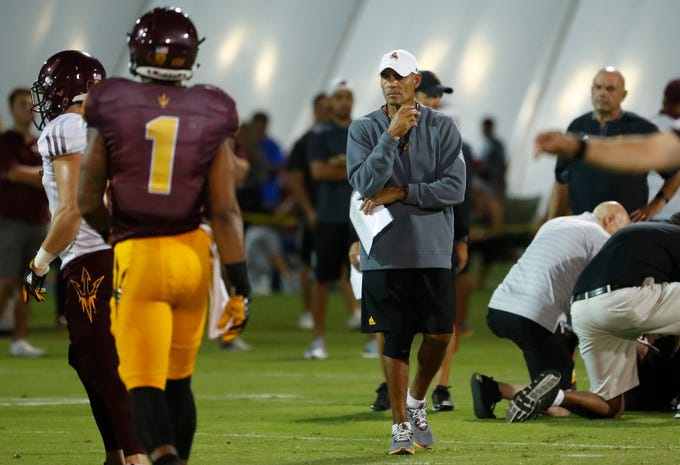 ASU's head coach Herm Edwards watches his team during the ASU scrimmage at Kajikawa Practice Fields in Tempe, Ariz. on Aug. 11, 2018.