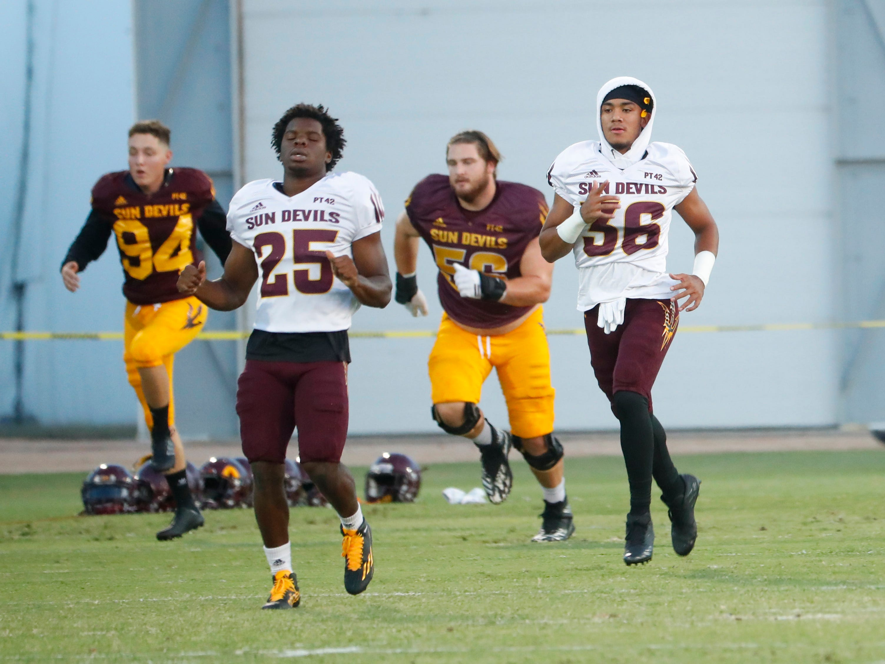 ASU players warmup during the ASU scrimmage at Kajikawa Practice Fields in Tempe, Ariz. on Aug. 11, 2018.