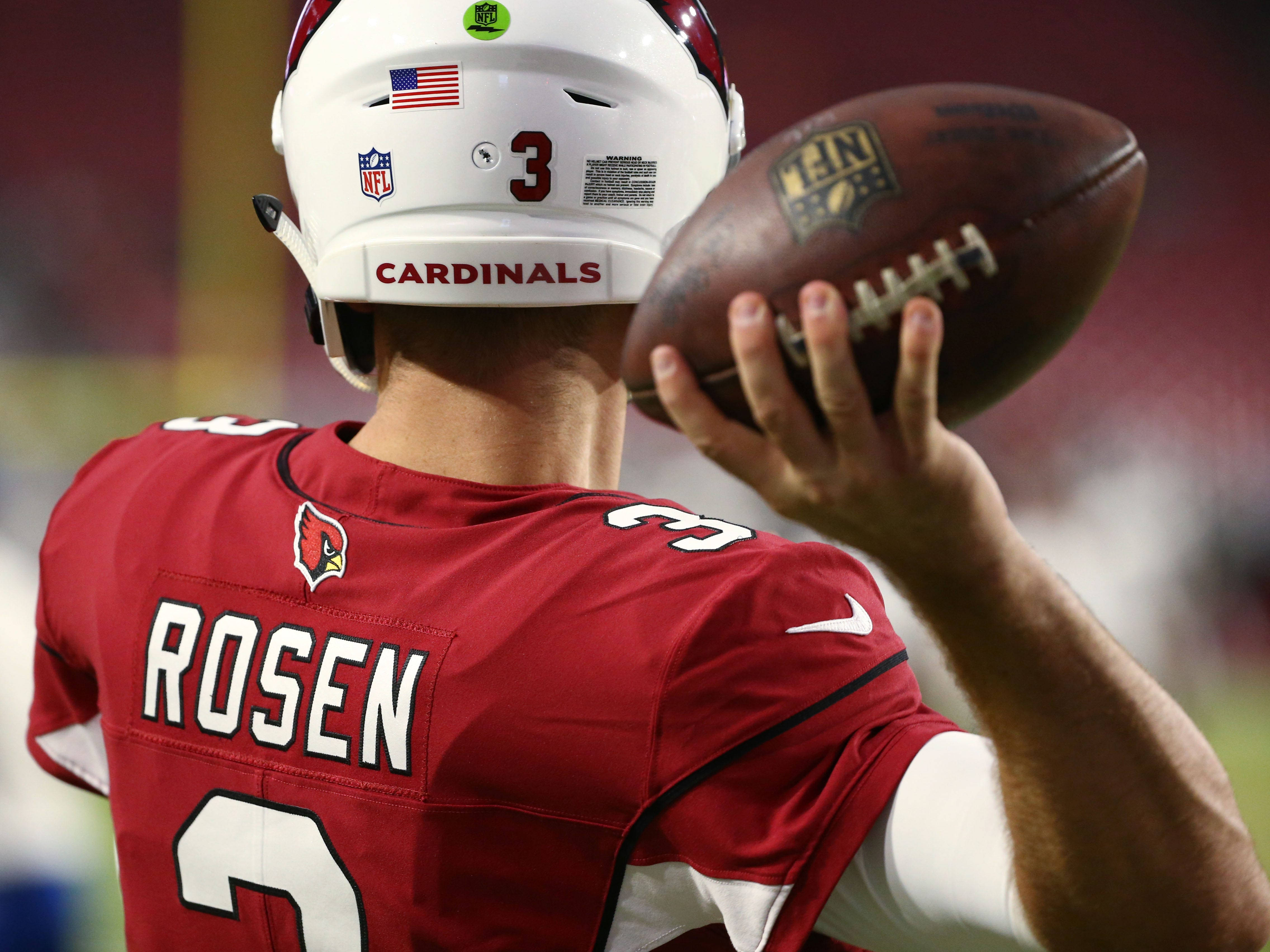 Arizona Cardinals quarterback Josh Rosen warms-up before playing the L.A. Chargers during a preseason NFL football game on Aug. 11, 2018 at University of Phoenix Stadium in Glendale, Ariz.
