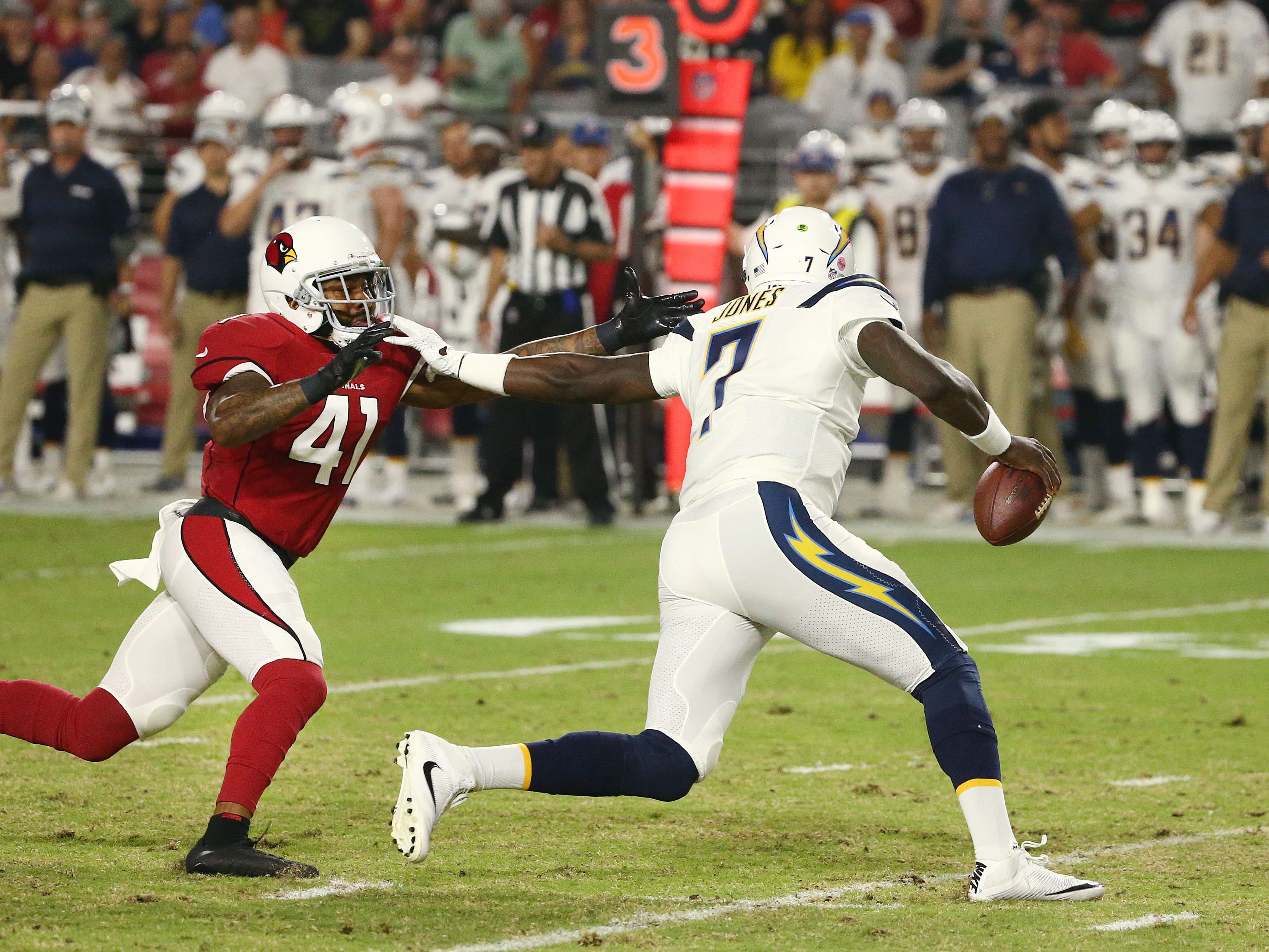 Arizona Cardinals Antoine Bethea chases L.A. Chargers quarterback Cardale Jones in the first half during a preseason NFL football game on Aug. 11, 2018 at University of Phoenix Stadium in Glendale, Ariz.