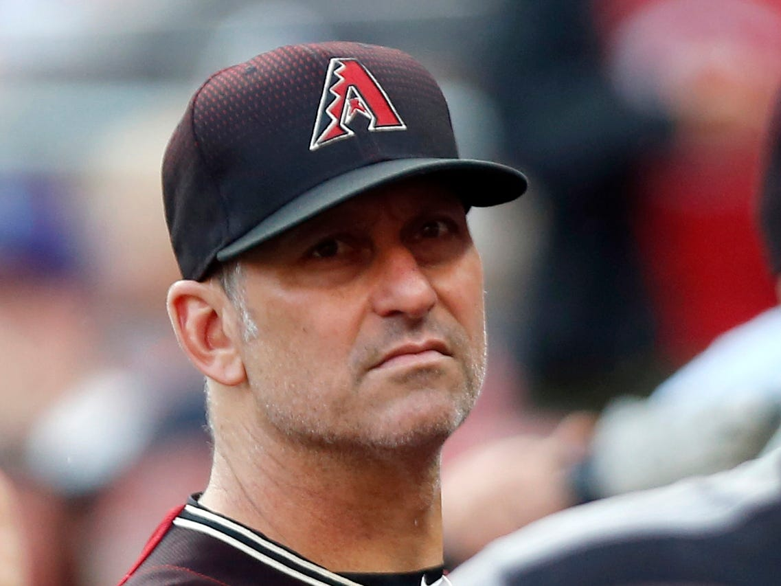 Aug 11, 2018; Cincinnati, OH, USA; Arizona Diamondbacks manager Torey Lovullo (17) watches from the dugout before a game against the Cincinnati Reds at Great American Ball Park. Mandatory Credit: David Kohl-USA TODAY Sports