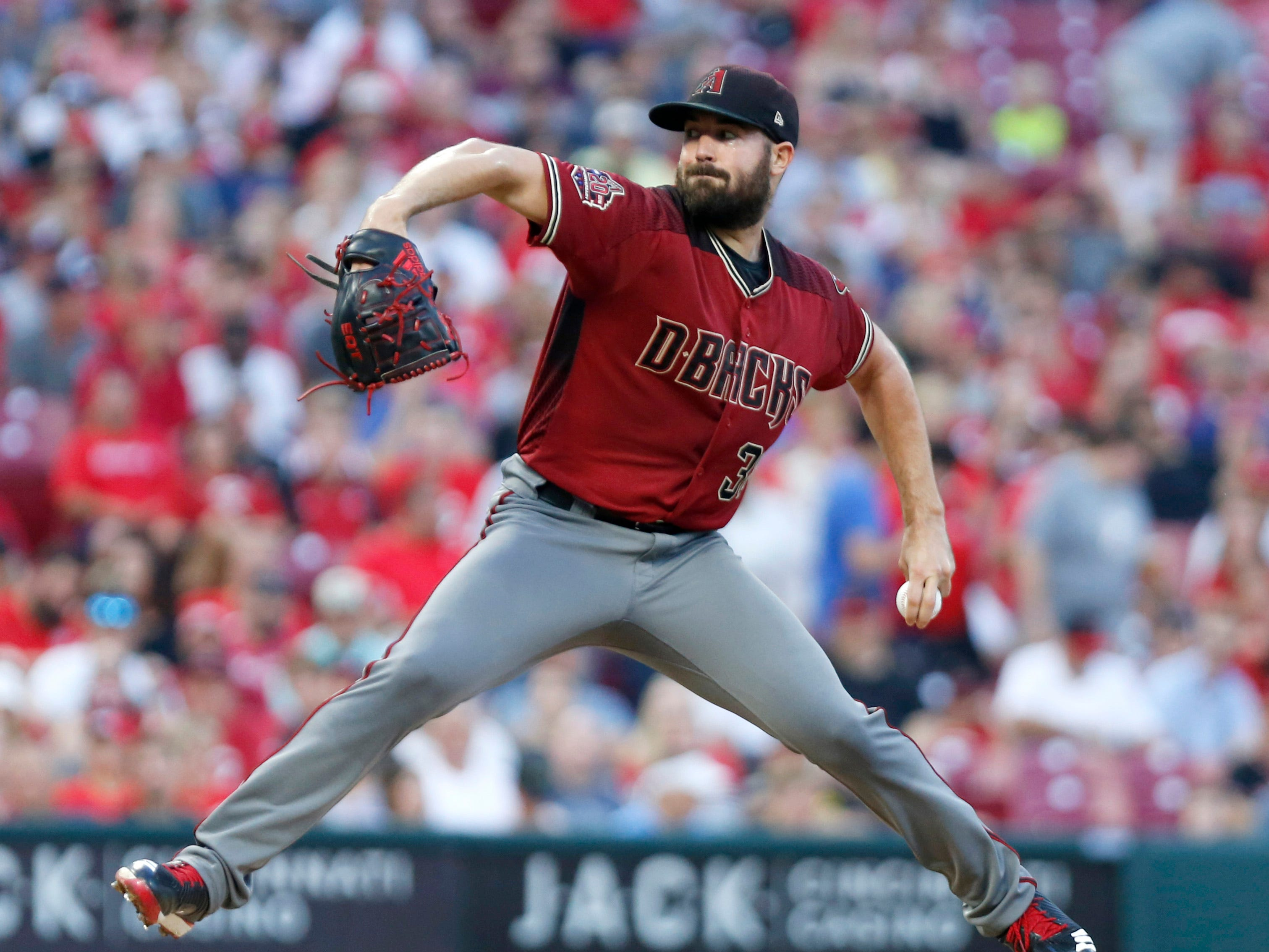 Aug 11, 2018; Cincinnati, OH, USA; Arizona Diamondbacks starting pitcher Robbie Ray (38) throws against the Cincinnati Reds during the first inning at Great American Ball Park. Mandatory Credit: David Kohl-USA TODAY Sports