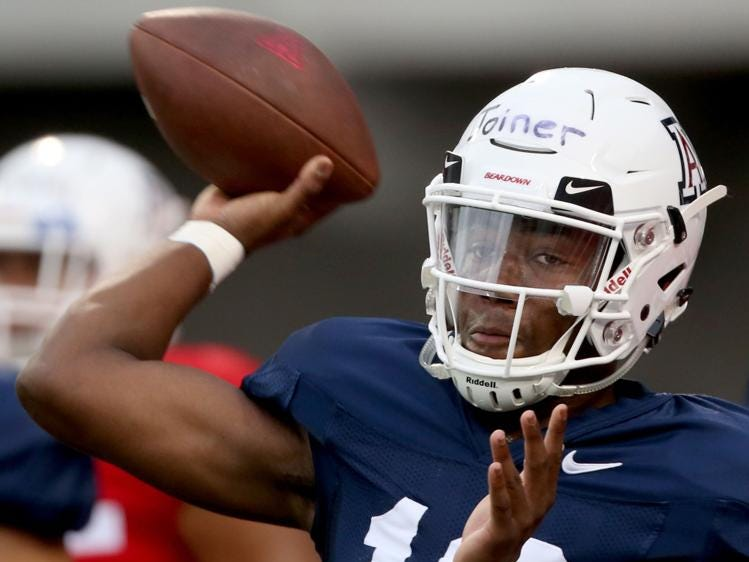 Freshman quarterback Jamarye Joiner cocks to throw as the University of Arizona continues preparing for the upcoming season, Friday, August 10, 2018, Tucson, Ariz.
