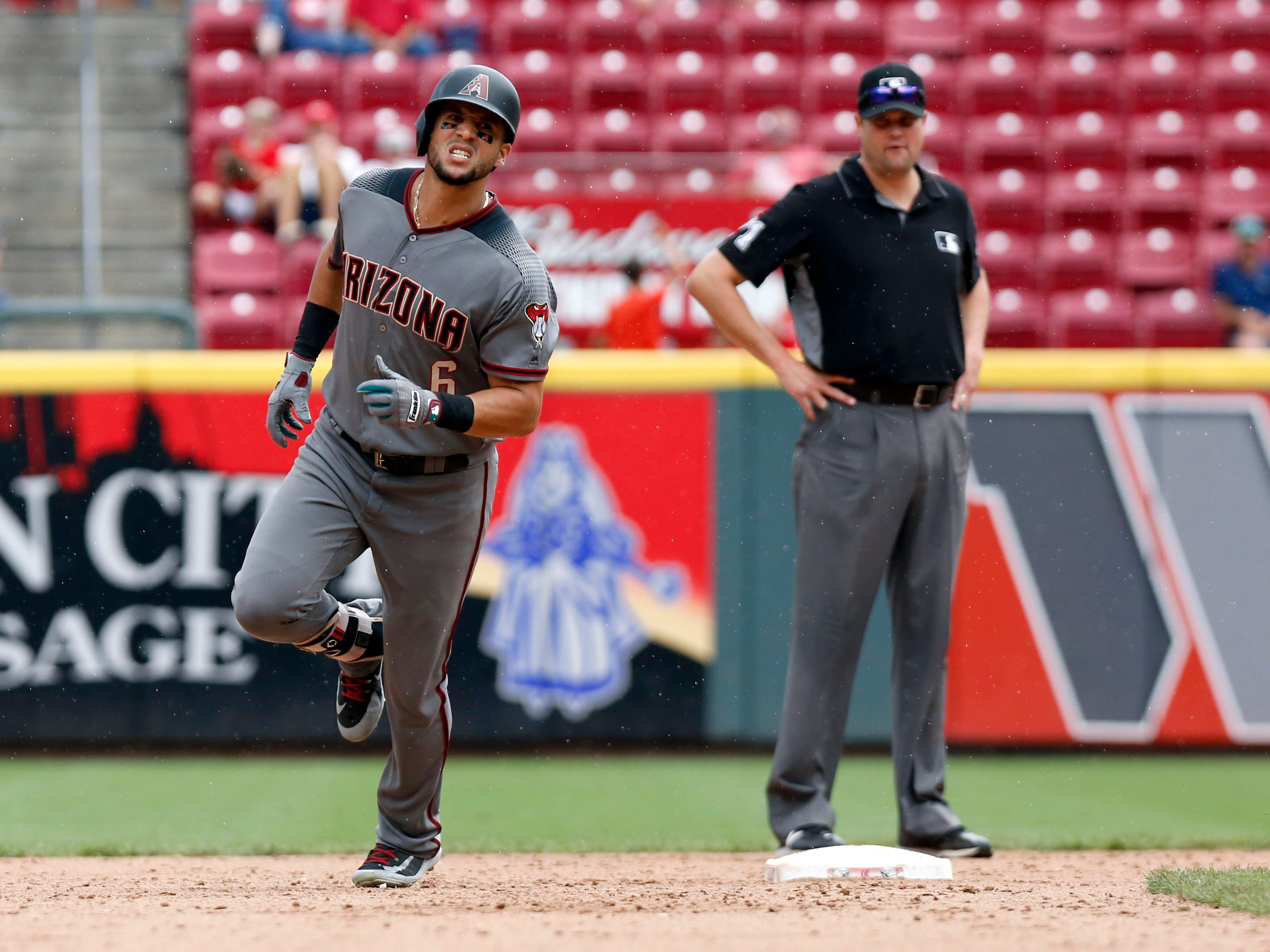 Aug 12, 2018; Cincinnati, OH, USA; Arizona Diamondbacks left fielder David Peralta (6) rounds the bases after hitting a solo home run against the Cincinnati Reds during the ninth inning at Great American Ball Park. Mandatory Credit: David Kohl-USA TODAY Sports