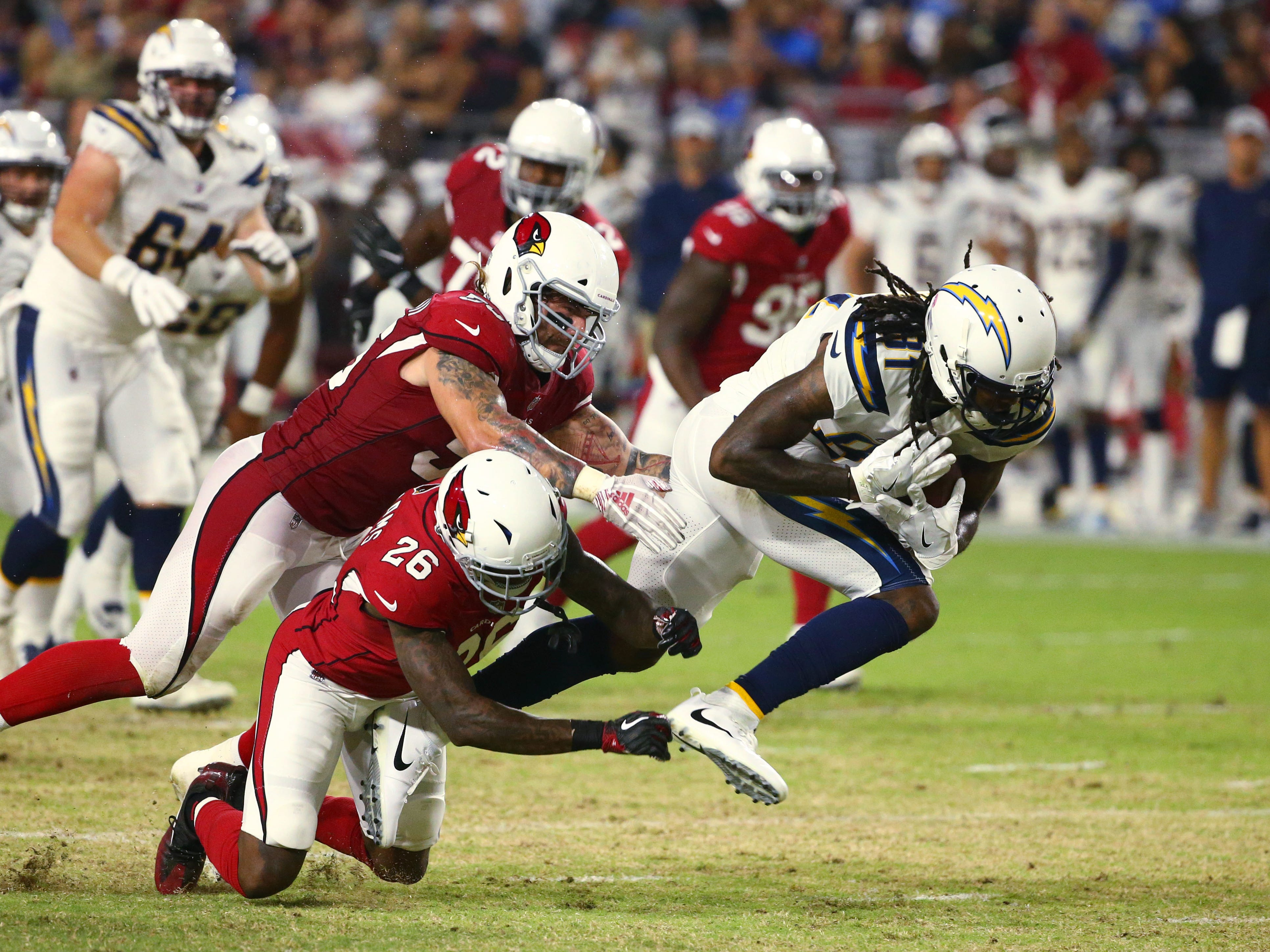 Arizona Cardinals 	Brandon Williams (26) tackles L.A. Chargers Mike Williams in the first half during a preseason NFL football game on Aug. 11, 2018 at University of Phoenix Stadium in Glendale, Ariz.