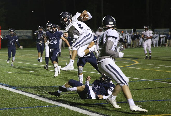 Pittsford quarterback Matt LaRocca leaps into the end zone on an 11-yard touchdown run against Webster Thomas last season.