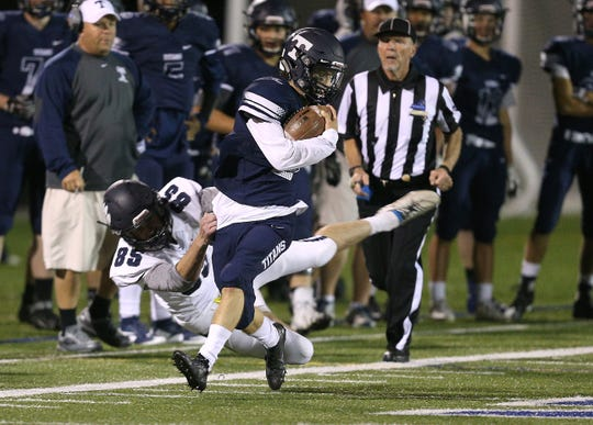 Webster Thomas' Collin Hill (2) is tackled  by Pittsford kicker Max Hopfinger after a long kickoff return during a game last season.