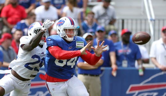 Bills tight end Nick O'Leary makes an inside move to catch a pass against safety Siran Neal.