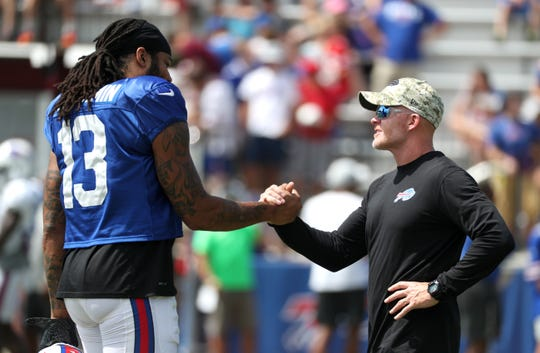 Bills head coach Sean McDermott  greets receiver Kelvin Benjamin before practice starts.
