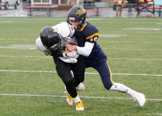 Victor's Kordell Jackson makes a tackle in a 2016 game against McQuaid.