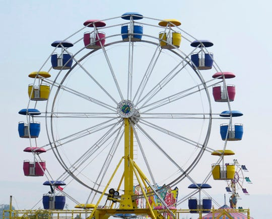 A Ferris wheel like the one pictured here on Thursday, Aug. 1, 2018 in Klamath is a staple at traveling carnivals. Jason Wold purchased this one used, but a new one can sell for approximately $750,000. The entire park can be taken down in 4 hours depending on what is up.