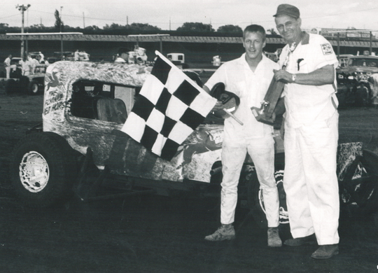 Fred Buckmiller (holding trophy) was the first hire of the newly formed Sioux Falls Stock Car Association in 1958. He was the promoter at the track from that time until his death in 1982.