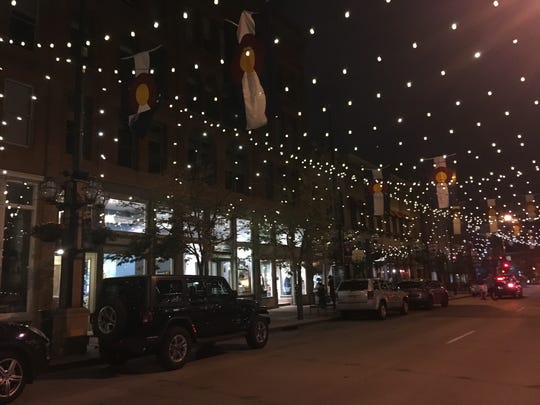 Denver's Larimer Square at night.