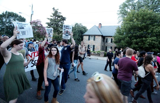 Hundreds fill the streets around Charlottesville as the Rally for Justice marched around the city on Saturday, Aug. 11, 2018 after abandoning the planned area around the UVA campus Rotunda. Student groups against white supremacy organized the rally on the one year anniversary of the Unite the Right rally.
