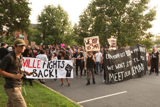 The Rally for Justice moved away from the planned area around the Rotunda on the UVA campus in Charlottesville on Saturday, Aug. 11, 2018. Student groups against white supremacy organized the rally on the one year anniversary of the Unite the Right rally.