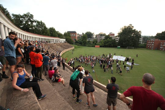 Hundreds participating in the Rally for Justice convened briefly on Lambeth Field before moving on into the city. The rally left the fenced off area around the Rotunda on the UVA campus in Charlottesville on Saturday, Aug. 11, 2018. Student groups against white supremacy organized the rally on the one year anniversary of the Unite the Right rally.