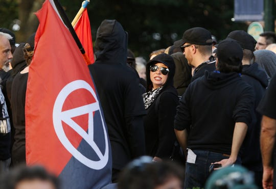 Groups carrying anarchist flags around the Rotunda for the UVA student led Rally for Justice in Charlottesville on Saturday, Aug. 11, 2018 where groups came to protest on the one year anniversary of the Unite the Right rally.
