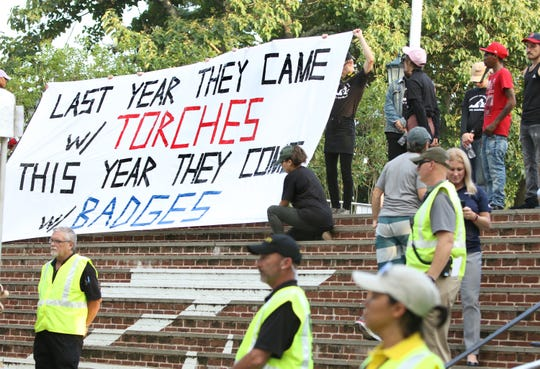 Students presented a banner to the crowd before moving the planned Rally for Justice away from the guarded Rotunda on the UVA campus in Charlottesville on Saturday, Aug. 11, 2018 on the one year anniversary of the Unite the Right rally.