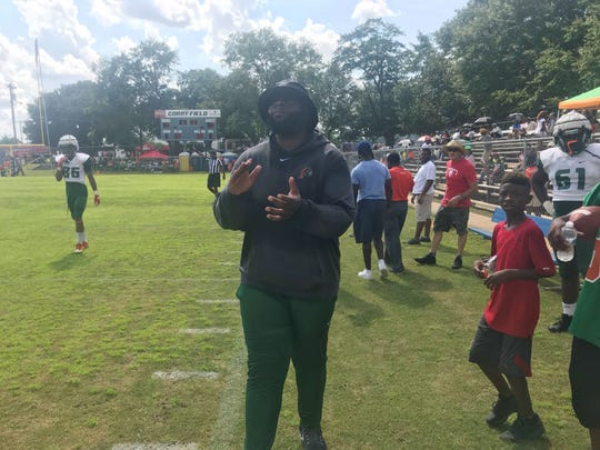 Quincy native Alex Jackson observes the action on the field. Jackson is a graduate of Shanks High School and now serves as offense coordinator/offensive line coach at FAMU.