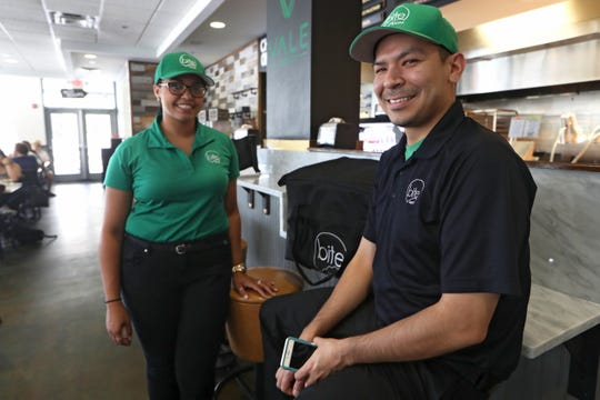 Jerry Underwood, operations manager of Bite Squad, a meal delivery service, with the company's local brand ambassador Breanna Maurisset at Vale Food Co.