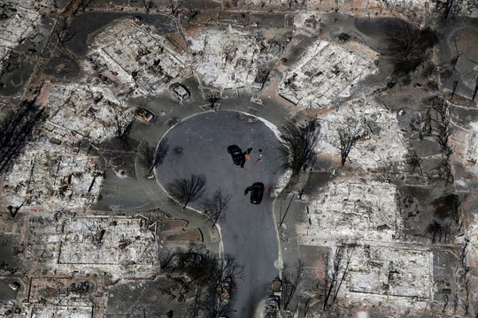 In this Oct. 14, 2017, file photo, an aerial view shows the devastation of the Coffey Park neighborhood after the Tubbs wildfire swept through Santa Rosa.  Tariffs on imported construction materials are making it more expensive to rebuild homes lost to wildfires and other natural disasters.