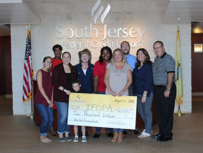 South Jersey Federal Credit Union employees recently presented a check for $2,000 to Kristi Gonzales, a local representative of the International Fibrodysplasia Ossificans Progressiva Association.  The donation will be used for disease awareness, research and clinical studies. The donation was part of Charitable Journey, an employee-sponsored charity program which allows employees to nominate a charity each quarter to receive donations made by SJFCU employees. As an incentive to donate, SJFCU employees who contribute are permitted to dress down for charity on Fridays.