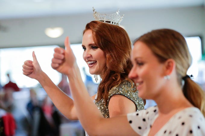 """Miss Wisconsin 2018 Tianna Vanderhei sings along to """"Ein Prosit"""" a German toast led by her father as he makes a speech remembering her journey of competing for multiple years before becoming Miss Wisconsin at the Miss America send off party for Vanderhei at Ridges Golf Course and Banquet Facility in Wisconsin Rapids on Sunday, Aug. 12, 2018. Vanderhei's first crown was as Miss Oktoberfest, where the song is regularly sung. Vanderhei will compete in the 2019 Miss America Competition Sunday, Sept. 9, 2018 in Atlantic City, New Jersey."""