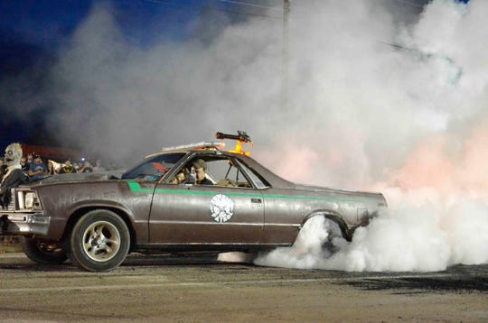"A ""Zombie Control"" competitor in the Summer's Last Blast Burnout Contest burns rubber in an effort to throw up all the smoke possible during the annual contest."