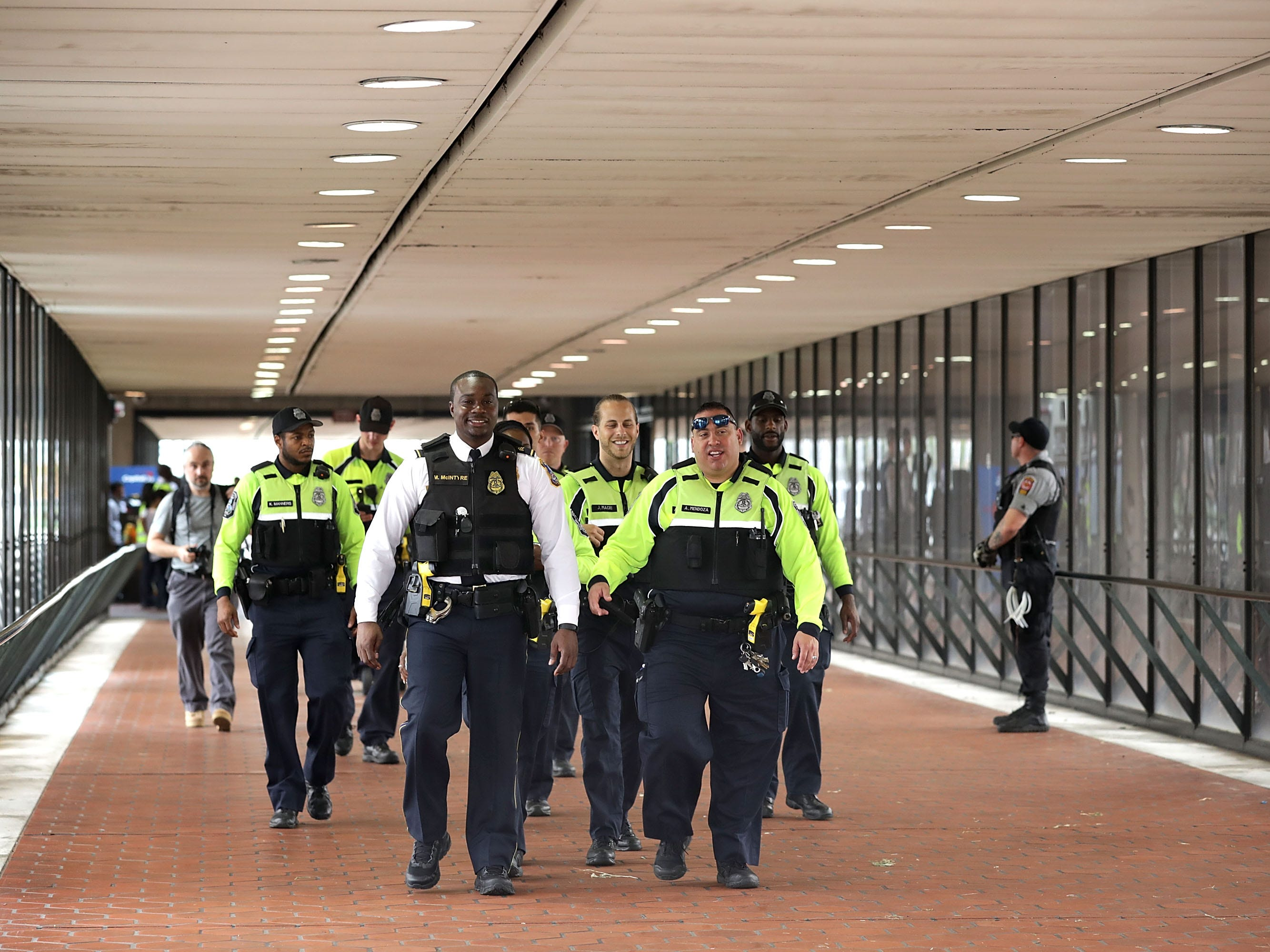 "Police stand watch at the Vienna/Fairfax Ñ GMU Metro Station in anticipation of the arrival of the white supremacist Unite the Right participants who plan to gather at the station before traveling to the White House Aug. 12, 2018 in Vienna, Va. Thousands of protesters are expected to demonstrate against the ""white civil rights"" rally in Washington, which was planned by the organizer of last yearÕs deadly rally in Charlottesville, Va."