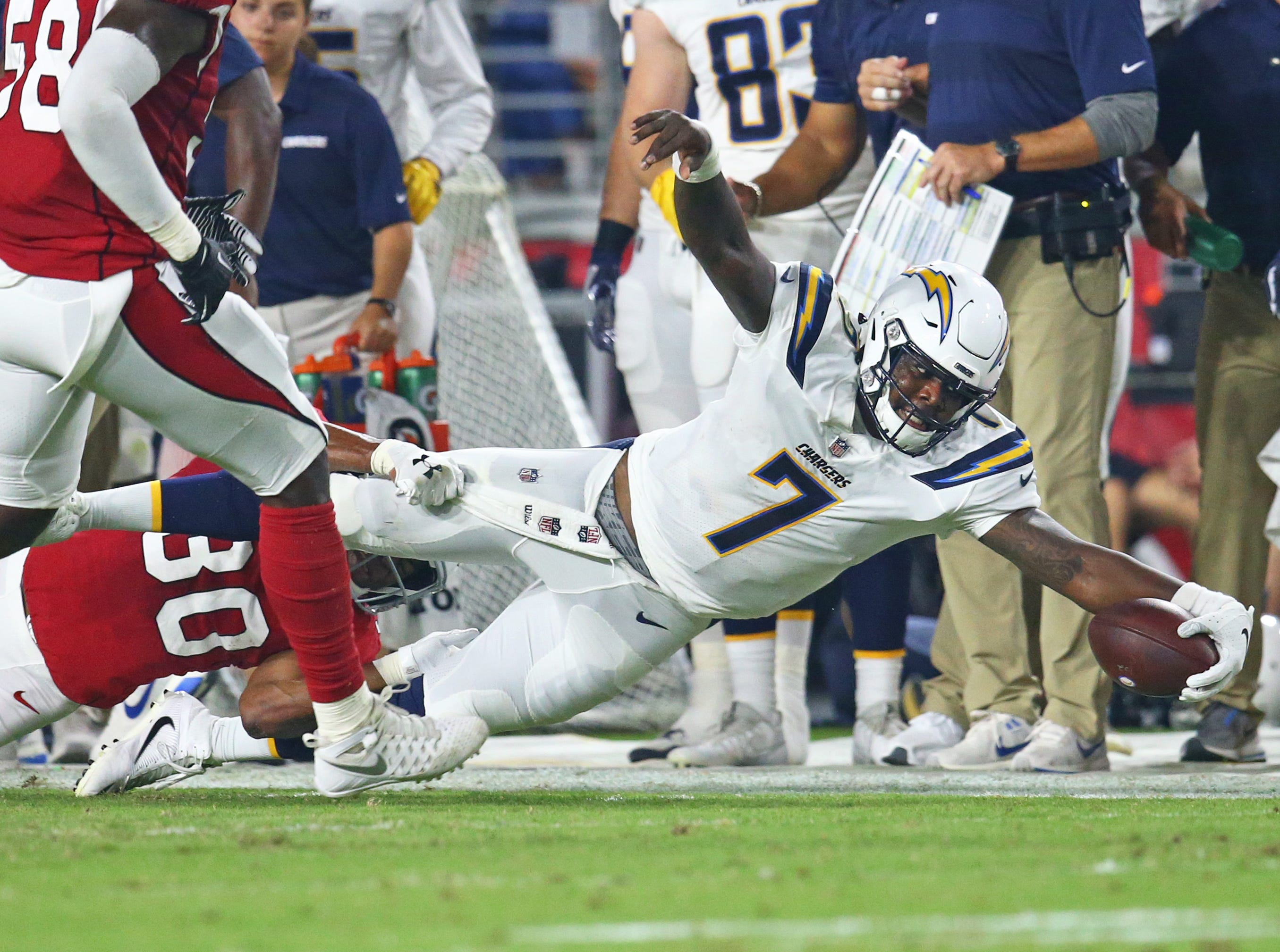 Los Angeles Chargers quarterback Cardale Jones (7) dives for yardage against the Arizona Cardinals during a preseason game at University of Phoenix Stadium.