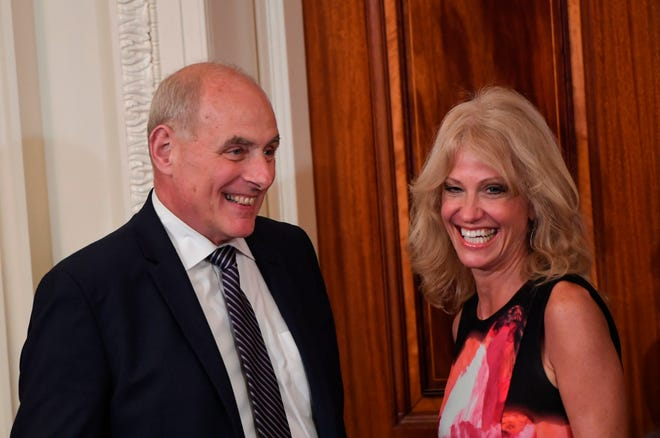 White House Chief of Staff John Kelly and White House counselor Kellyanne Conway arrive before President Donald Trump holds a press conference at the the White House July 30, 2018.