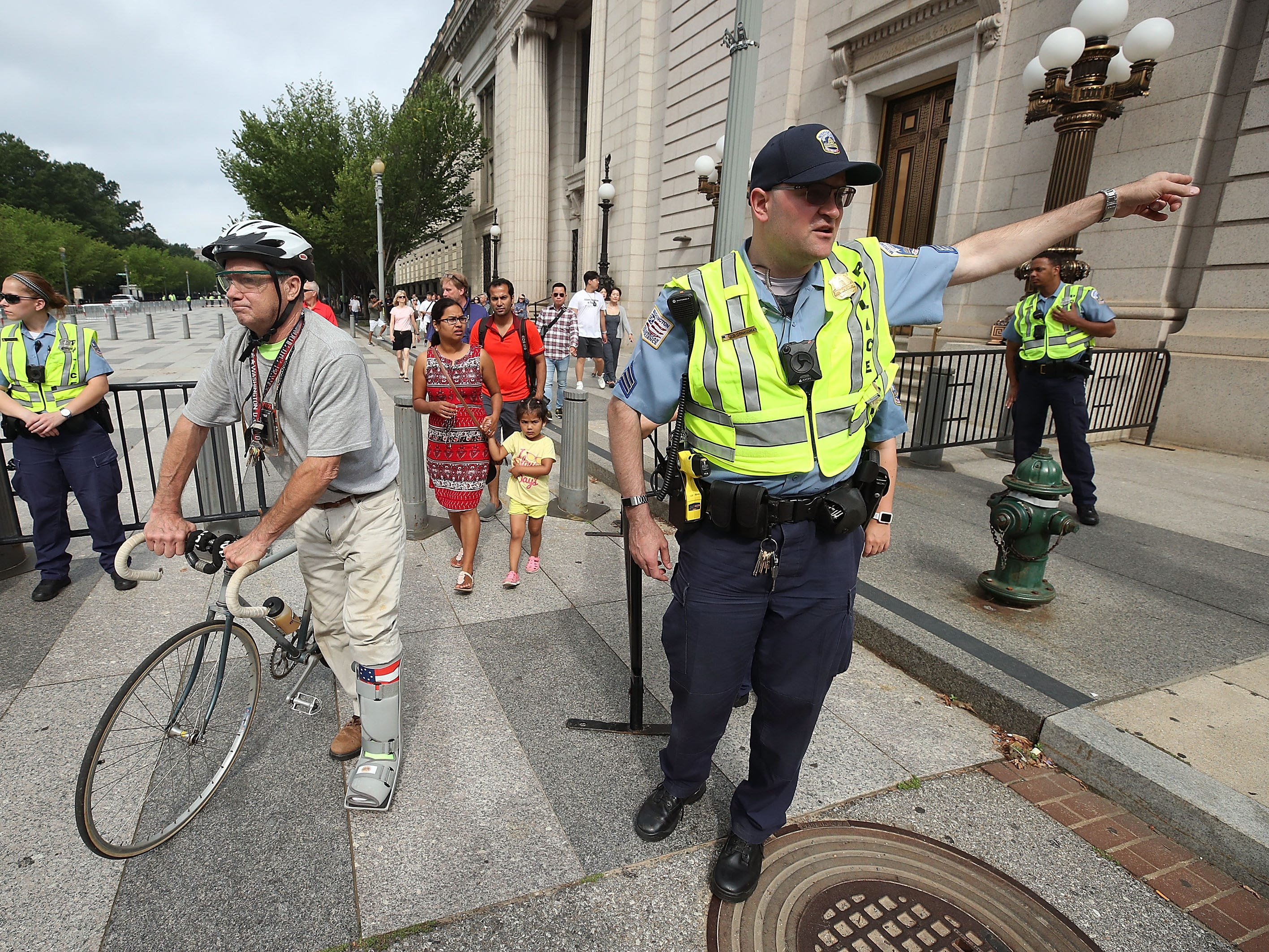 DC Metropolitan Police close down Pennsylvania Ave. to pedestrian traffic ahead of a white supremacists, neo-Nazis, members of the Ku Klux Klan and other hate groups gathering for the Unite the Right rally in Lafayette Park across from the White House Aug. 12, 2018 in Washington, DC.