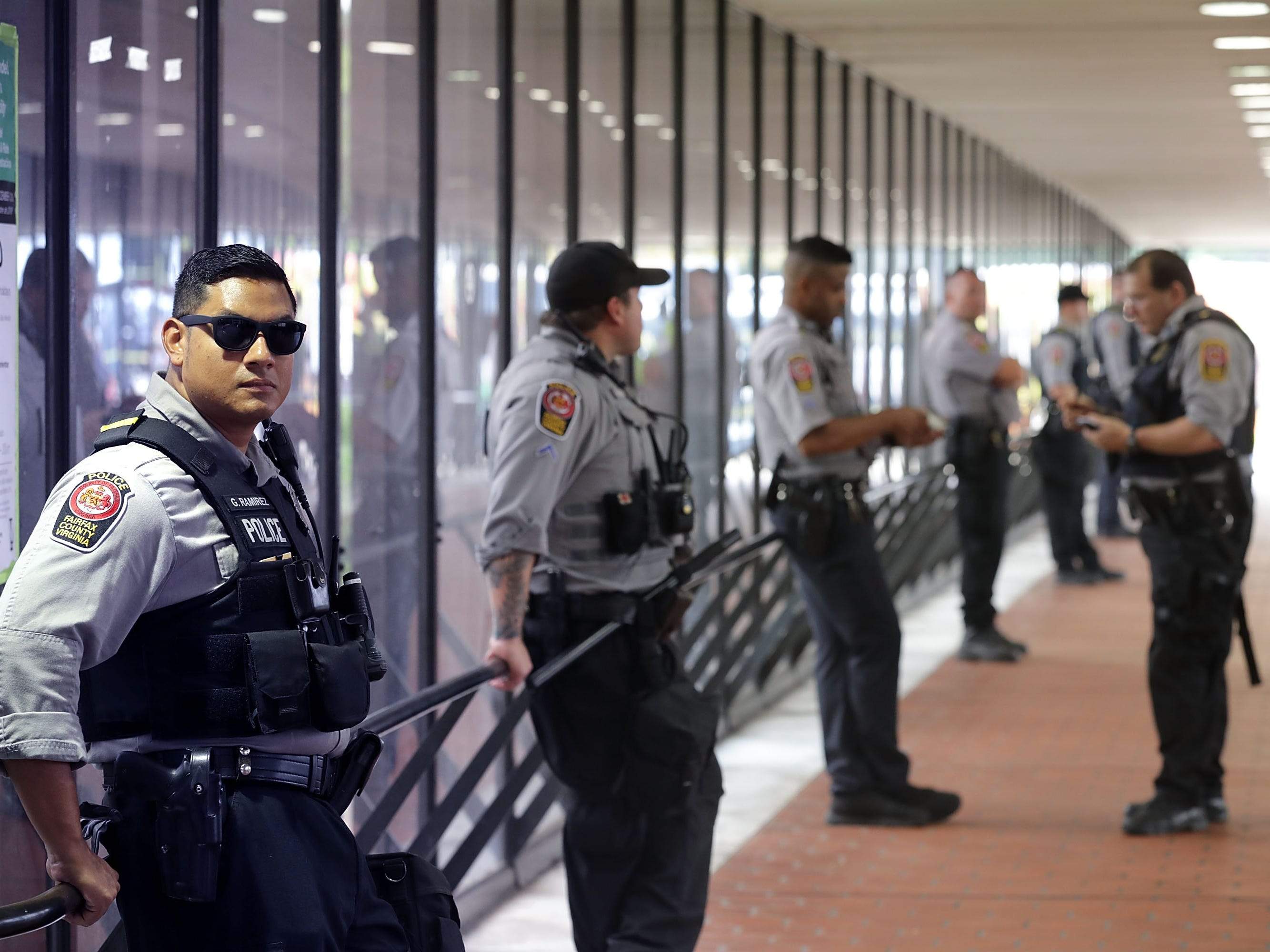 Police stand watch at the Vienna/Fairfax Ñ GMU Metro Station in anticipation of the arrival of the white supremacist Unite the Right participants who plan to gather at the station before traveling to the White House Aug. 12, 2018 in Vienna, Va.