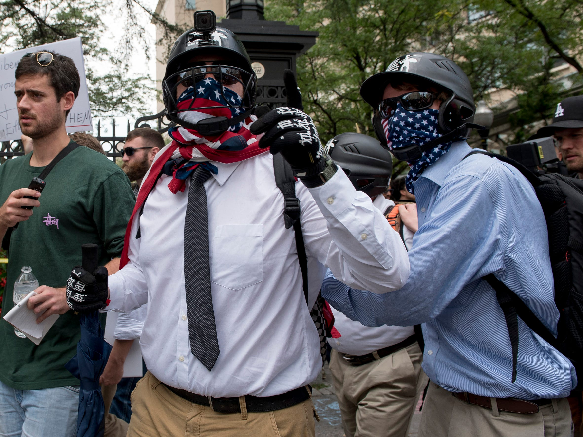 Some white nationalists arrive near the Foggy Bottom metro station during the Unite the Right rally on Aug. 12, 2018 in Washington.