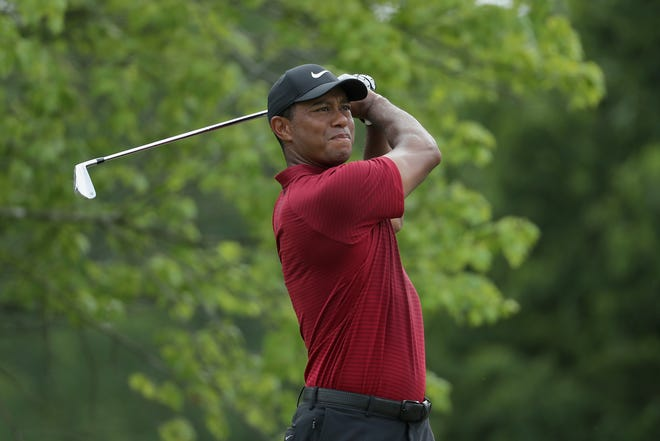 Tiger Woods plays his shot from the second tee during the final round of the 2018 PGA Championship at Bellerive Country Club.