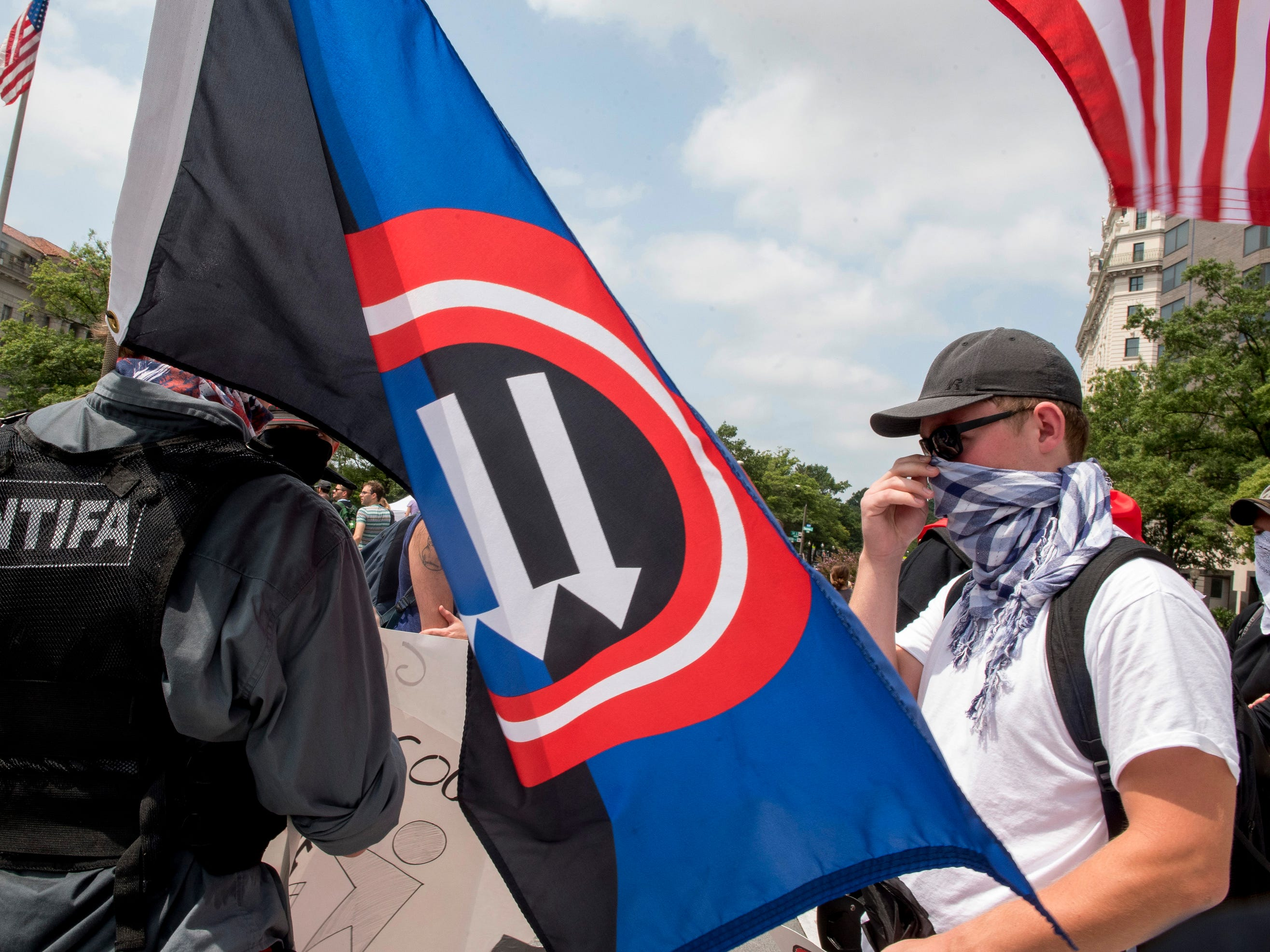 Participants gather at Freedom plaza before the Unite the Right rally on Aug. 12, 2018 in Washington. A year ago and 120 miles southwest of Washington, a Unite the Right rally in Charlottesville, Virginia, turned deadly. Heather Heyer, a 32-year-old legal assistant, was struck and killed when a white supremacist slammed his car into a counter-protest. And two Virginia state troopers died when their surveillance helicopter crashed near the protests.