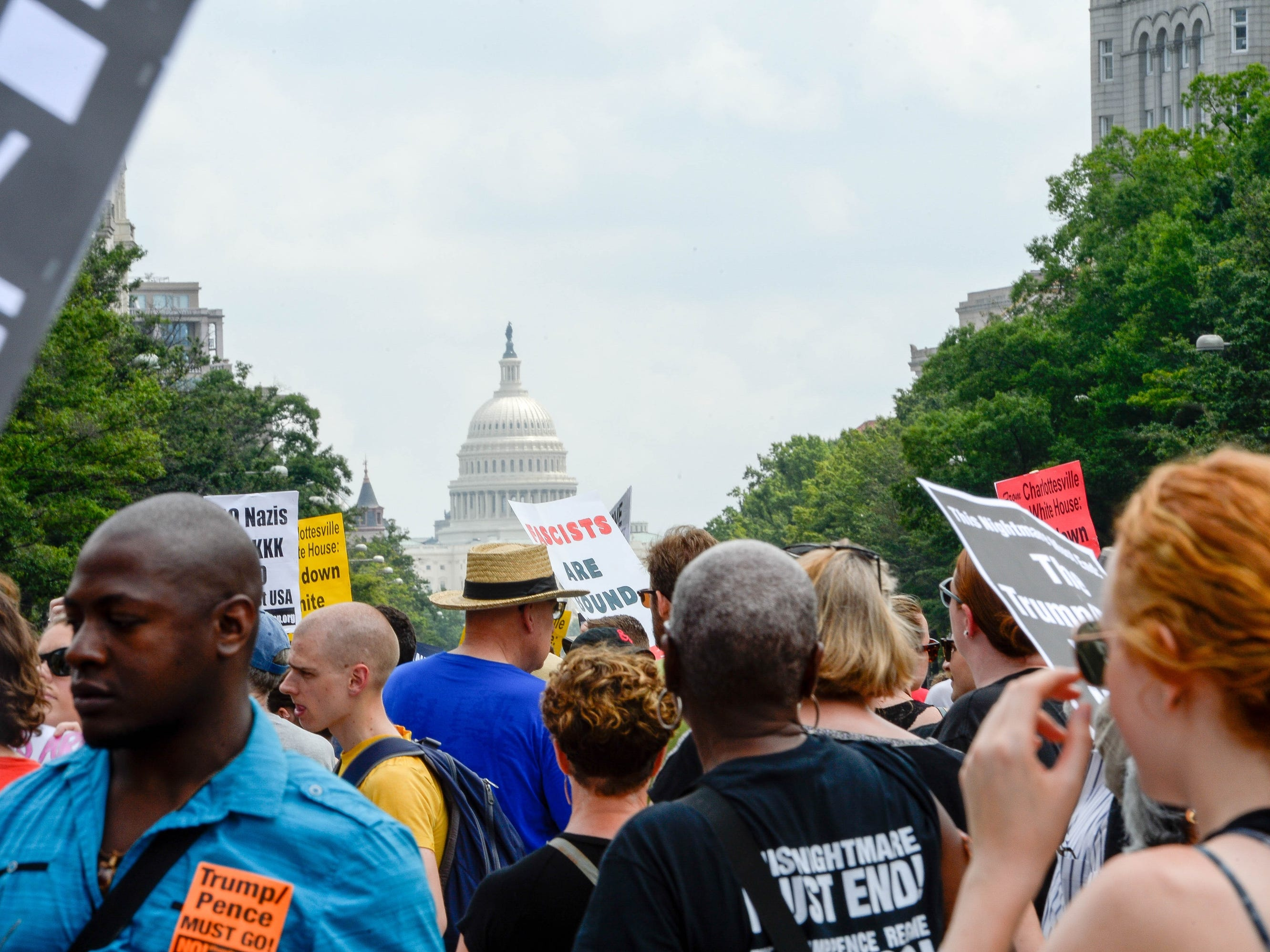 Participants gather at Freedom plaza during the Unite the Right rally on Aug. 12, 2018 in Washington. A year ago and 120 miles southwest of Washington, a Unite the Right rally in Charlottesville, Va, turned deadly. Heather Heyer, a 32-year-old legal assistant, was struck and killed when a white supremacist slammed his car into a counter-protest. And two Virginia state troopers died when their surveillance helicopter crashed near the protests.