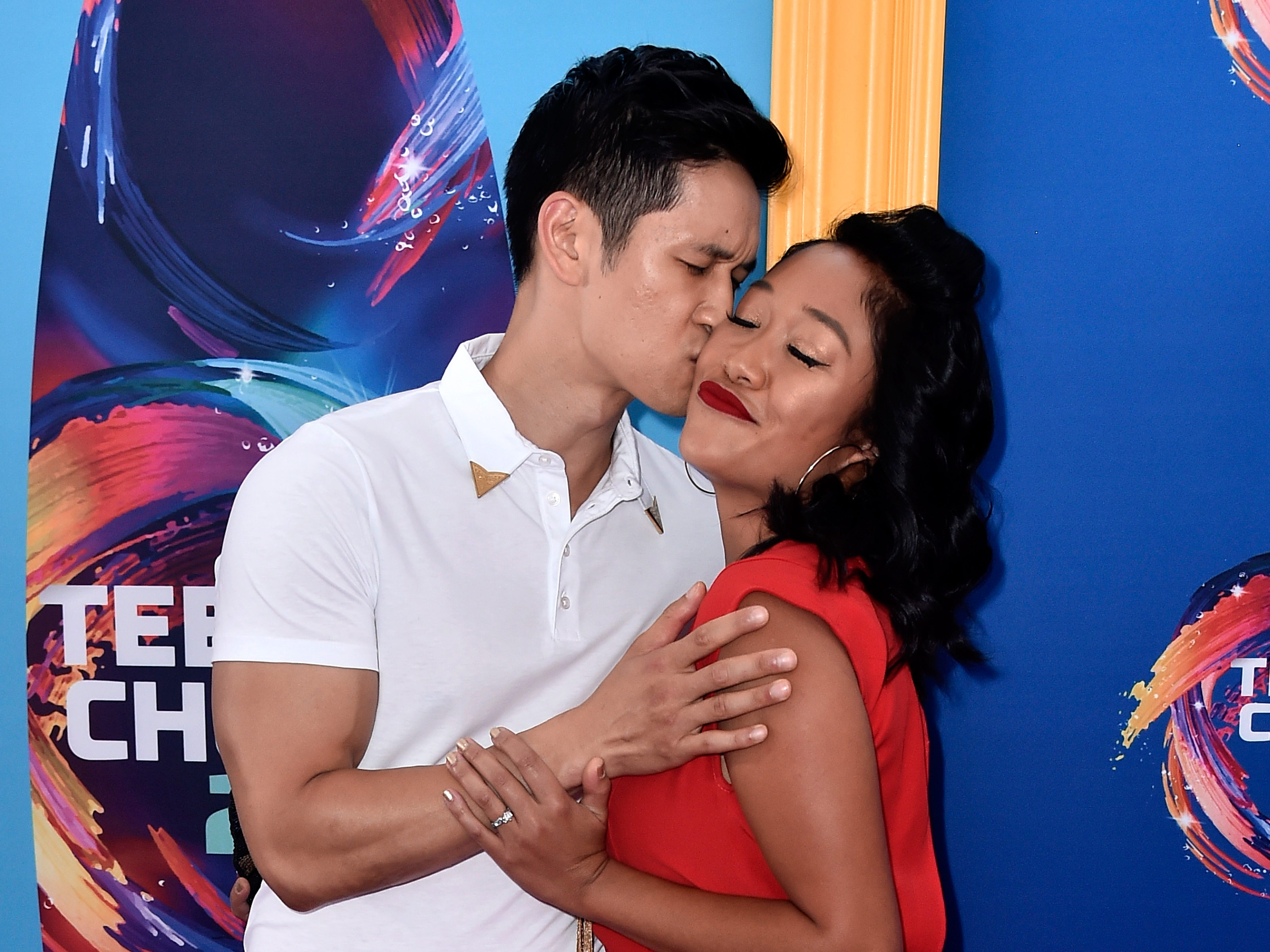 INGLEWOOD, CA - AUGUST 12:  Harry Shum Jr. (L) and Shelby Rabara kiss during FOX's Teen Choice Awards at The Forum on August 12, 2018 in Inglewood, California.  (Photo by Frazer Harrison/Getty Images) ORG XMIT: 775199256 ORIG FILE ID: 1015792838