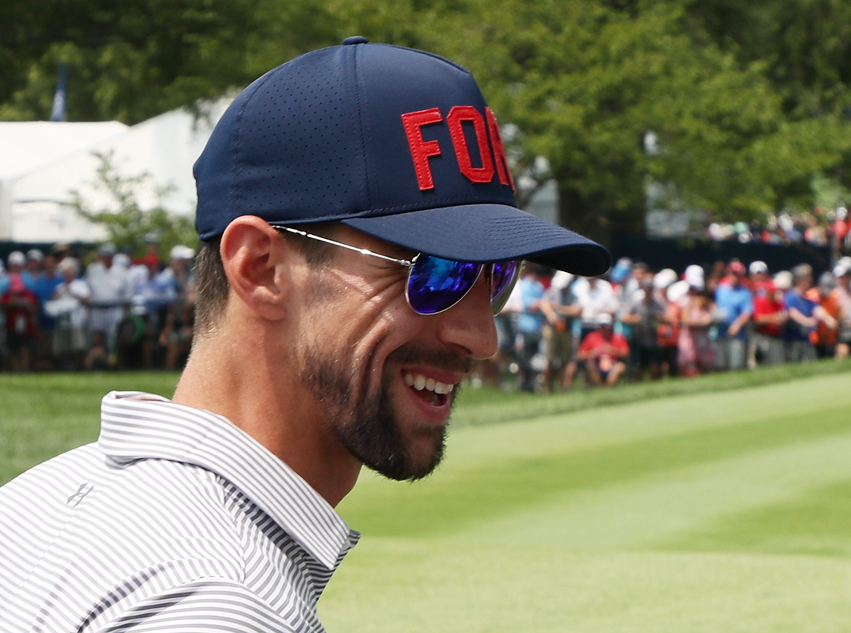 Olympic champion Michael Phelps looks on during the final round of the 2018 PGA Championship at Bellerive Country Club.
