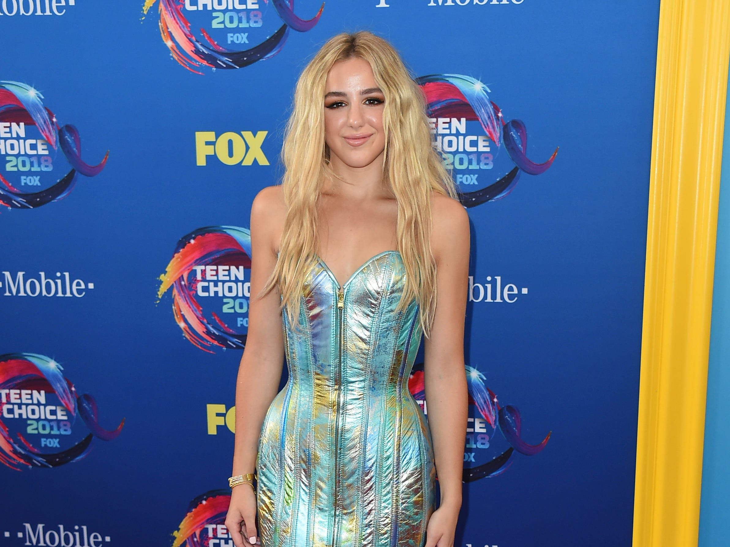 Chloe Lukasiak arrives at the Teen Choice Awards at The Forum on Sunday, Aug. 12, 2018, in Inglewood, Calif. (Photo by Jordan Strauss/Invision/AP) ORG XMIT: CAPM109
